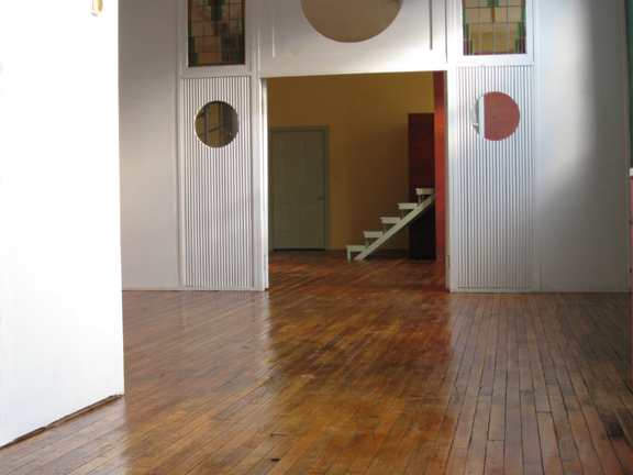 The hard wood floors are featured in this photograph of the central area in the Loft