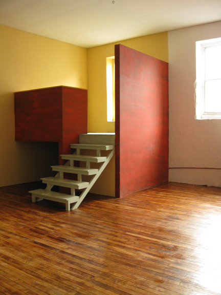 Photograph of a space that can function either as a sleeping loft or an office
